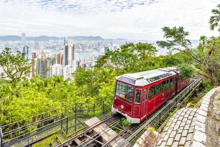 Victoria Peak Tram and Skyscraper buildings with Victoria Harbour, Victoria Peak, Hong Kong Фото со стока
