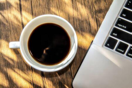 A Cup of Espresso Coffee with Computer Notebook Foto de archivo