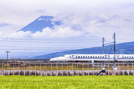 High Speed Train passing Fuji Mountain Background in Summer, Fuji City, Shizuoka, Japan Editorial