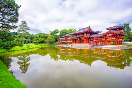 Red Phoenix Hall Reflection in Small Pond of Byodoin Temple in Summer, Uji, Kyoto, Japan