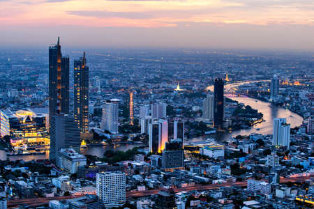 Skyscraper Building with Curved of Chao Phraya River at Sunset, Bangkok