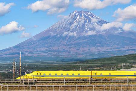 High Speed Bullet Train Doctor Yellow Shinkansen  on railway with Fuji Mountain Background, Fuji, Shizuoka Editorial