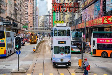 Hong Kong 2 Storeys Tram run on railroad passing Business Shopping Arcade, Hong Kong