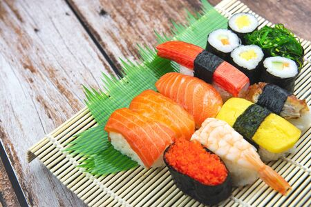 Sushi Set on Bamboo Plate with wooden background