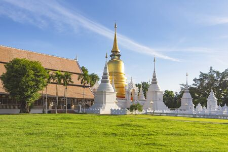 Great Golden Pagoda surrounding smaller white pagodas at Wat Suan Dok Temple, Chiangmai, Thailand