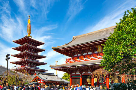 Tourists enjoy sightseeing Historical Architecture of Sensoji Temple in Autumn, Asakusa, Tokyo