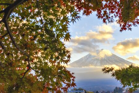 Fuji Mountain with Misty Fog and Red Maple Leaves at Sunset, Kawaguchiko Lake, Japan