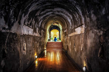 Buddhist praying golden buddha image in the small hall of Wat U Mong Temple, Chiangmai, Thailand Foto de archivo - 149407685