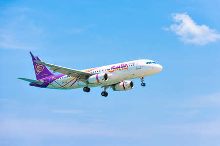 Aircraft Airbus a320 of Thai Smile Airways landing on runway at Phuket International Airport in Clear Sky, Phuket Island, Thailand
