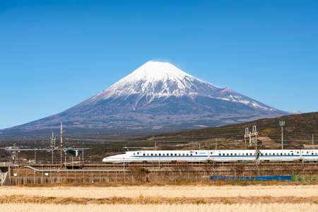 Japan - January 31, 2019 : HIgh Speed Bullet Train Tokaido Shinkansen running pass rice field with Fuji Mountain Background, Shin-Fuji, Shizuoka Editorial