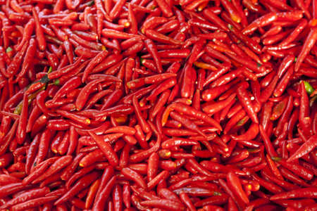 Fresh red hot chillies in market Stock Photo