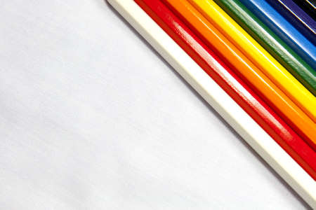 Colored pens cross the white canvas in background Stock Photo - 16755300