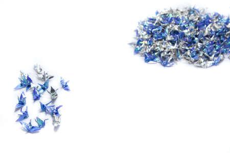 青と銀の折り紙の鳥 写真素材