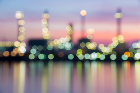 gas supply: Oil refinery at twilight in blurry bokeh effect Stock Photo