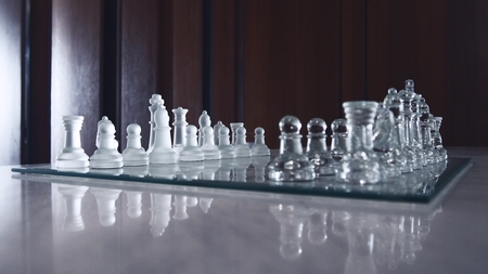 chessman: beautiful glassy chessboard and all chessman,color filter and selective focus Stock Photo