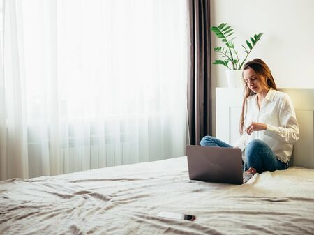 Girl learns, works, self-develops online while sitting at home