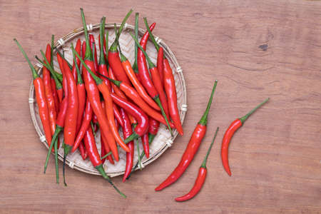 Red Chili on wooden background, top view Stock Photo