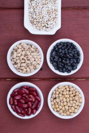 Jobs tears, Soy beans, Red beans, black beans, and navy bean on dark wooden background