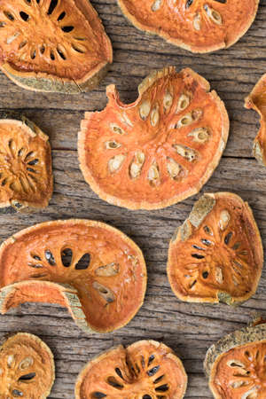 Dried quince in pattern on wooden table