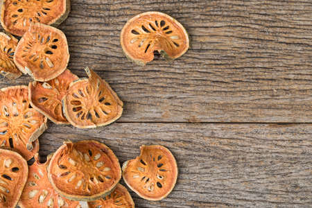 Dried quince on wooden table Фото со стока