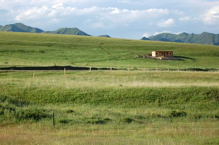 tibetan house: lonely house on grassy slope
