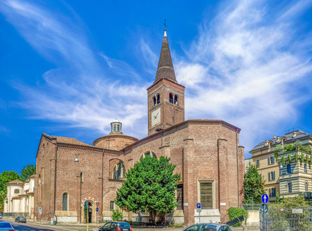 ecclesiastical: Side view of Church of San Marco in Milan, Italy. Dedicated to St. Mark. Beautiful wide angle picture with colorful blue sky and white clouds