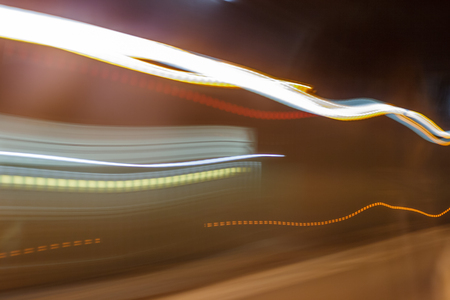 Inside tunel blur abstract scene traveling by bus looking in the window upcoming cars Stock Photo