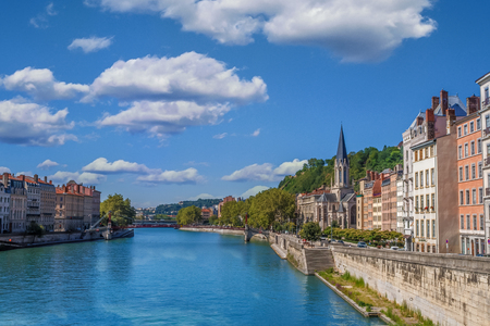 The river Saone view with Church of Saint Georges and footbridge in the city center of Lyon, France Stock Photo