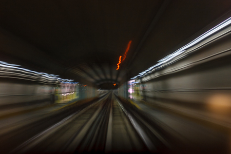 Inside tunel blur abstract scene traveling by train looking forward In Italian subway metro