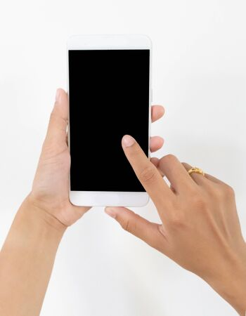Female hand holding a white cell phone with a black screen at an isolated background.