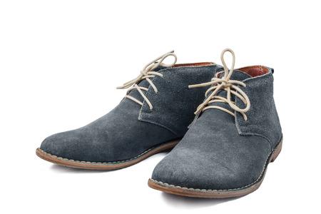 白い背景の青いスエードの靴