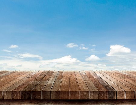 wood shelf on blue sky background