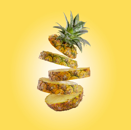 Slice pineapple isolated on yellow background with clipping path