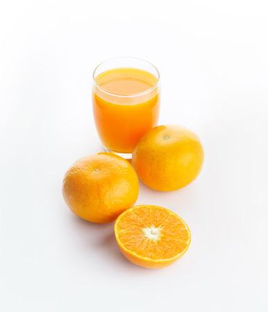 Isolated of glass of orange juice and a slice of orange fruit on white background