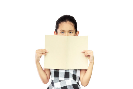 Cute asian girl covered her face with a book isolated on white background with clipping path