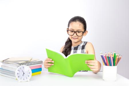 Cute asian girl enjoying her study ,reading book prepare on her exam