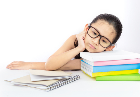 Cute asian girl tired on her study or her homework with her head down on a stack of book