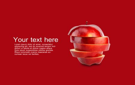 Stack of red apple sliced on red background with copy space and sample text Stock Photo