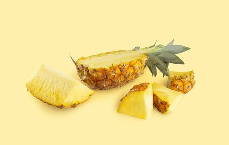 Isolated set of pineapple on yellow bacground