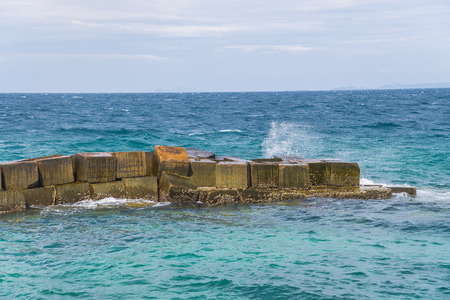 revetment: wave crash and splash on Seawall Revetment