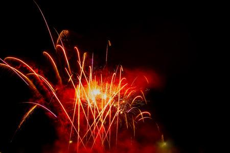 xmas background: xmas and new year colorful firework celebrate on isolated background
