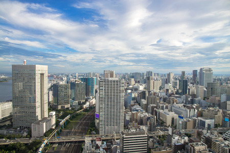 described: Cityscape of Tokyo City, Japan - Tokyo is the worlds most populous metropolis and is described as one of the three command centers for world economy