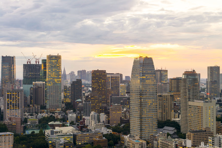 described: sunset Cityscape of Tokyo City, Japan - Tokyo is the worlds most populous metropolis and is described as one of the three command centers for world economy Stock Photo