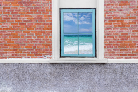 beach window: view seascape from wooden window and brick wall, Beautiful tropical beach and blue sky sea and sky, phuket, thailand Stock Photo