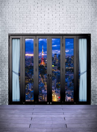 art door: view cityscape Tokyo Skyline, japan city cityscape at twilight from black Aluminum door with glass frame and white brick wall