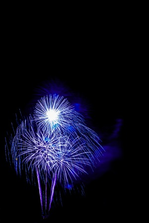 pyrotechnics: colorful fireworks -  beautiful colorful firework isolated display for celebration happy new year and merry christmas on black isolated background
