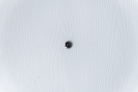 Close Up White Wood And Door Peephole On Texture Stock Photo