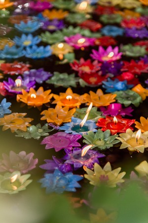 Floating flower candles in water  for make merit in the Buddhist, .Colourful candles lotus.