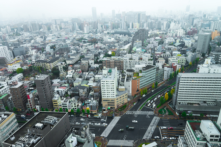 populous: Cityscapes of tokyo in Fog after rain in winter season, Skyline of Bunkyo ward, Tokyo, Japan, Tokyo is the worlds most populous metropolis and is described as command centers for world economy.