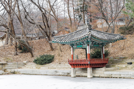 republic of korea: Changdeok Palace or Changdeokgung - Secret Garden Pagodas and Crack on an ice surface of the frozen Pond in winter season, Seoul, republic Korea, Korea traditional architecture